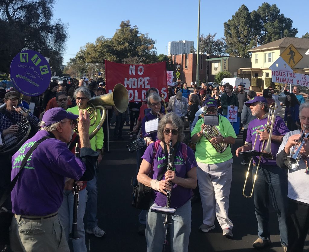 MAG members play music during the march.