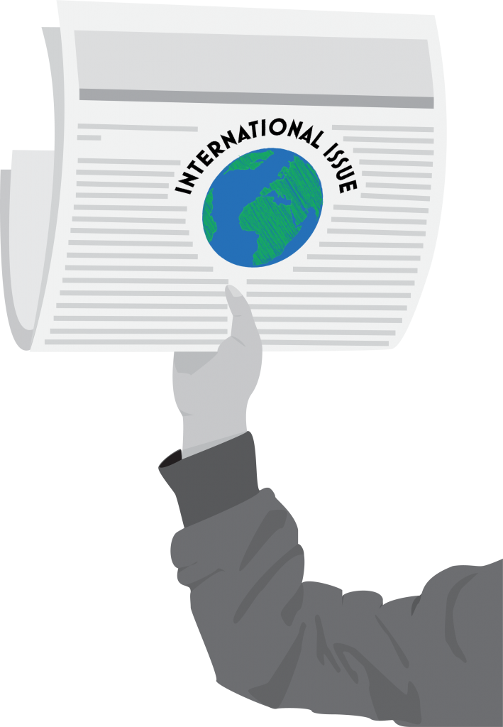 "A digital image of a person's arm holding up a newspaper. The text is not read-able, except in the middle there is a logo of a globe with the words ""international issue"" over the top."