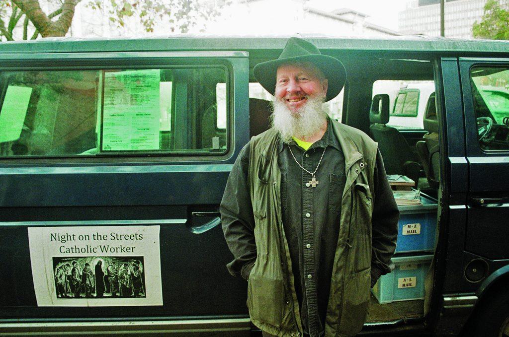 Photo of JC Orton outside of his van.