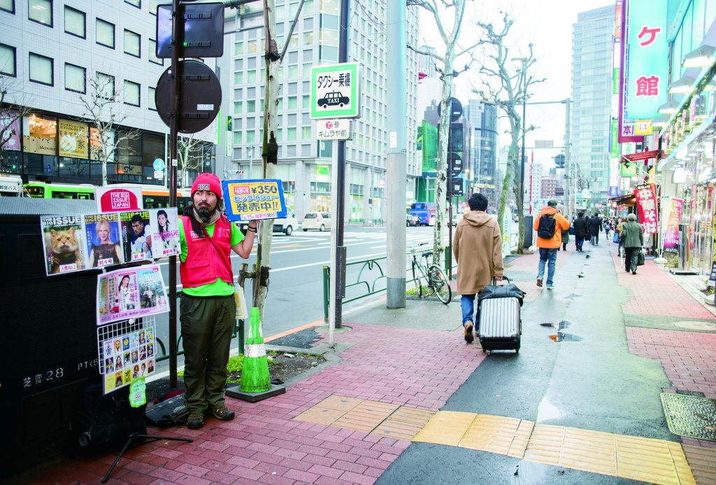 Nishi sells copies of The Big Issue in Toyko.