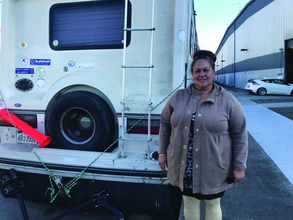 Photo of Kimberly with her RV.