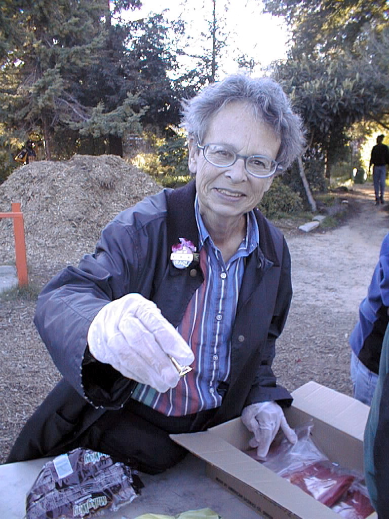 Hartmann smiles for a photo while serving food to the homeless in People's Park.