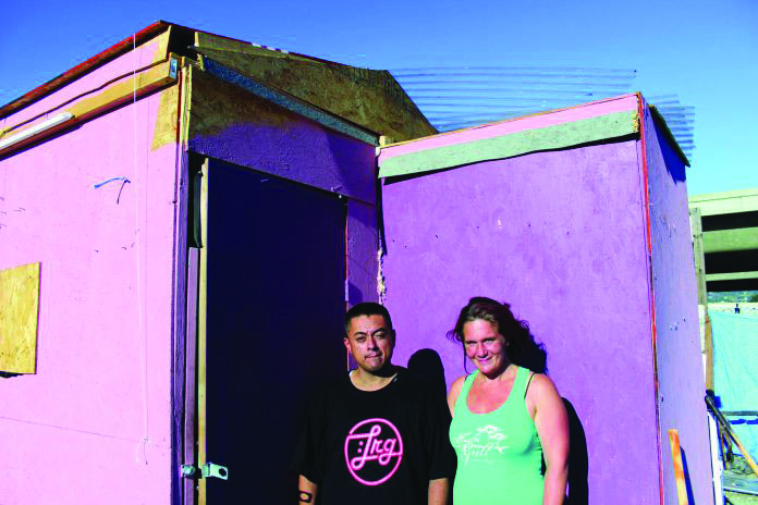 José Vargas and Jillian Wright stand outside their home at the High Street encampment.