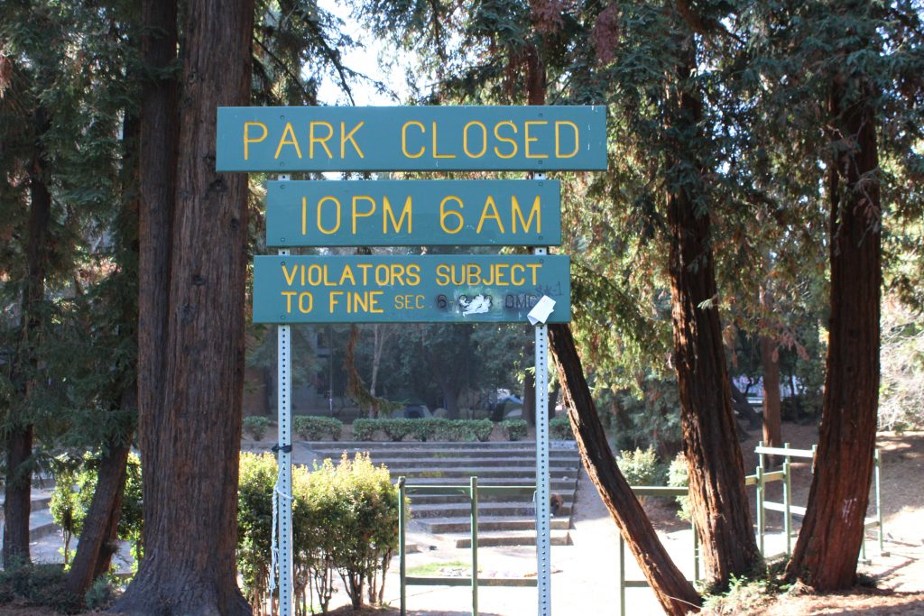 "A sign at Oakland's Mosswood Park reads ""park closed 10 pm - 6 am violators subject to fine"""