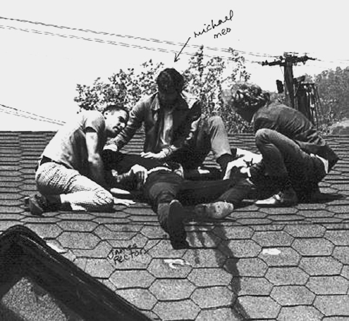 James Rector lays on a rooftop after he is shot.