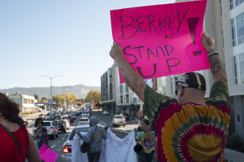 "Protestors on University Ave. Man holds, ""Berkeley Stand up!"" sign."