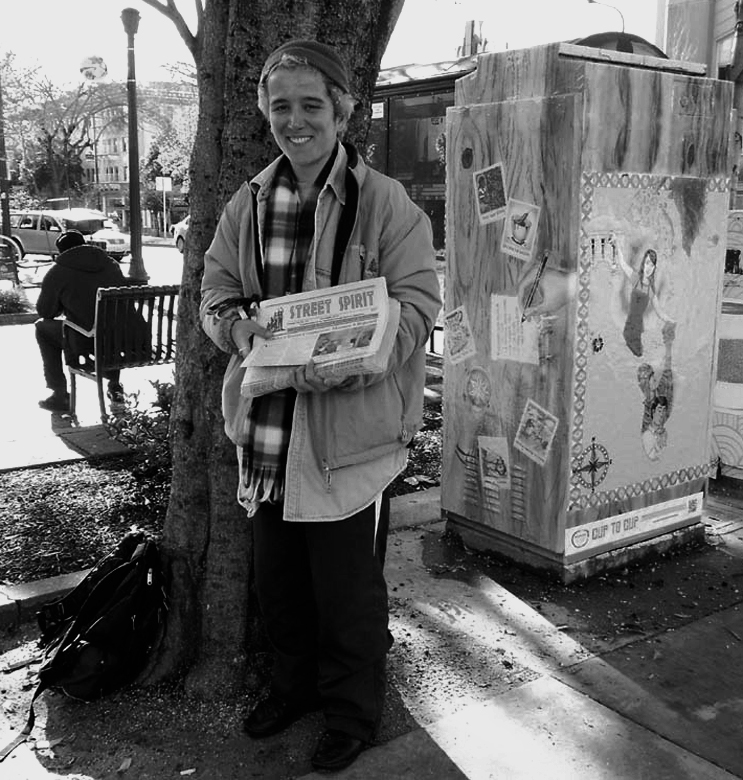 Photo of vendor holding stack of Street Spirits.