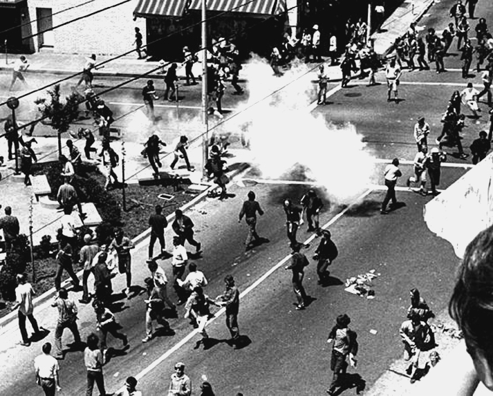 Protestors run from tear gas on Bloody Thursday.