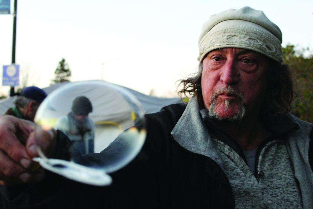 Robin Silver balances a bubble on his bubble wand.