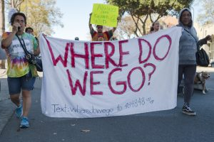 "Andrea Henson and Melanie Lacy hold a sign that reads, ""Where Do We Go?"""