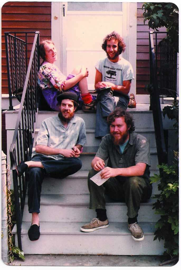 Food Not Bombs co-founders Susan Eaton, Brian Feigenbaum, CT, and Keith McHenry sitting outside their home in Cambridge, Massachusetts in 1981.