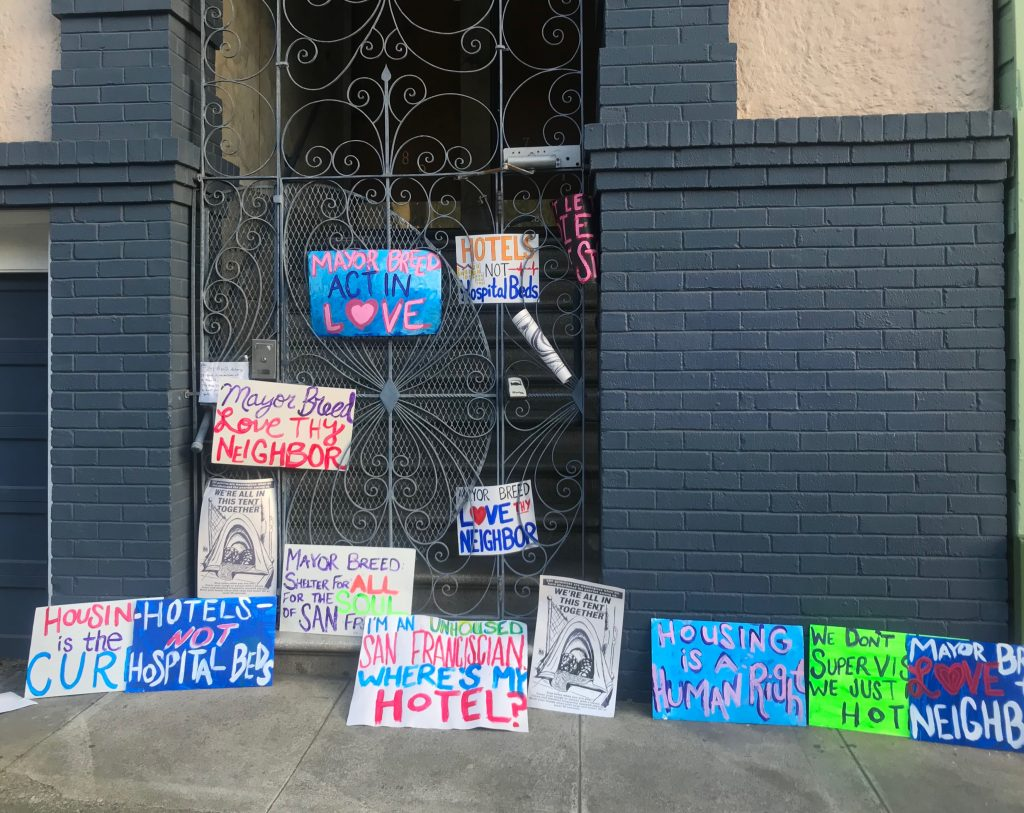 "Colorful protest signs left on the mayor's doorstep. Messages read ""mayor breed act in love"", ""mayor breed love thy neighbor,"" ""I'm an unhoused San Franciscan where's my hotel?"" as well as other messages."
