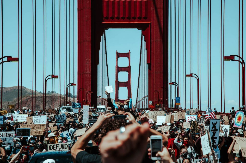 Protesters storm the golden gate bridge. Hundreds spill into the roadway and halt traffic on the Golden Gate Bridge.