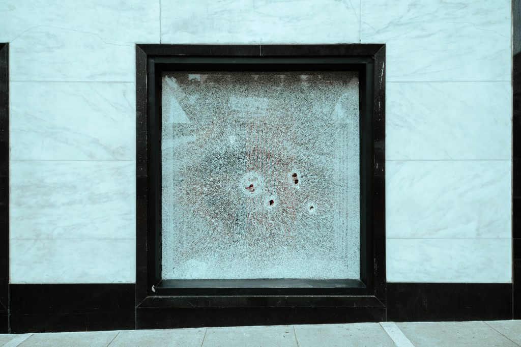 A shattered window in Union Square.