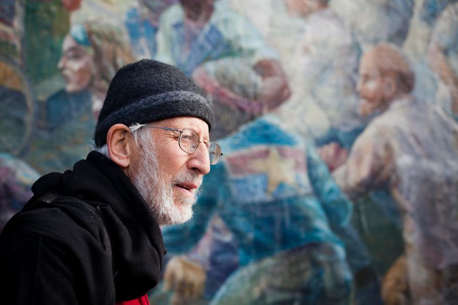 Osha in front of his mural on Haste Street in Berkeley.