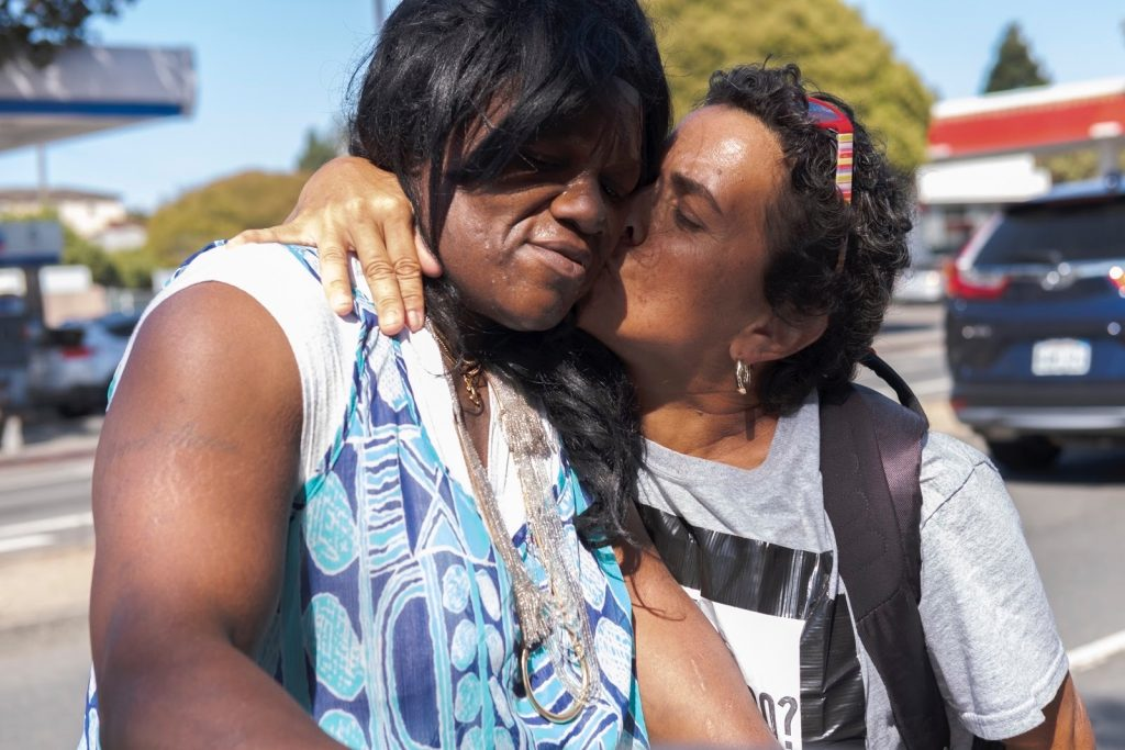 Andrea kisses Ms. West on the cheek during a march to Berkeley City Hall.