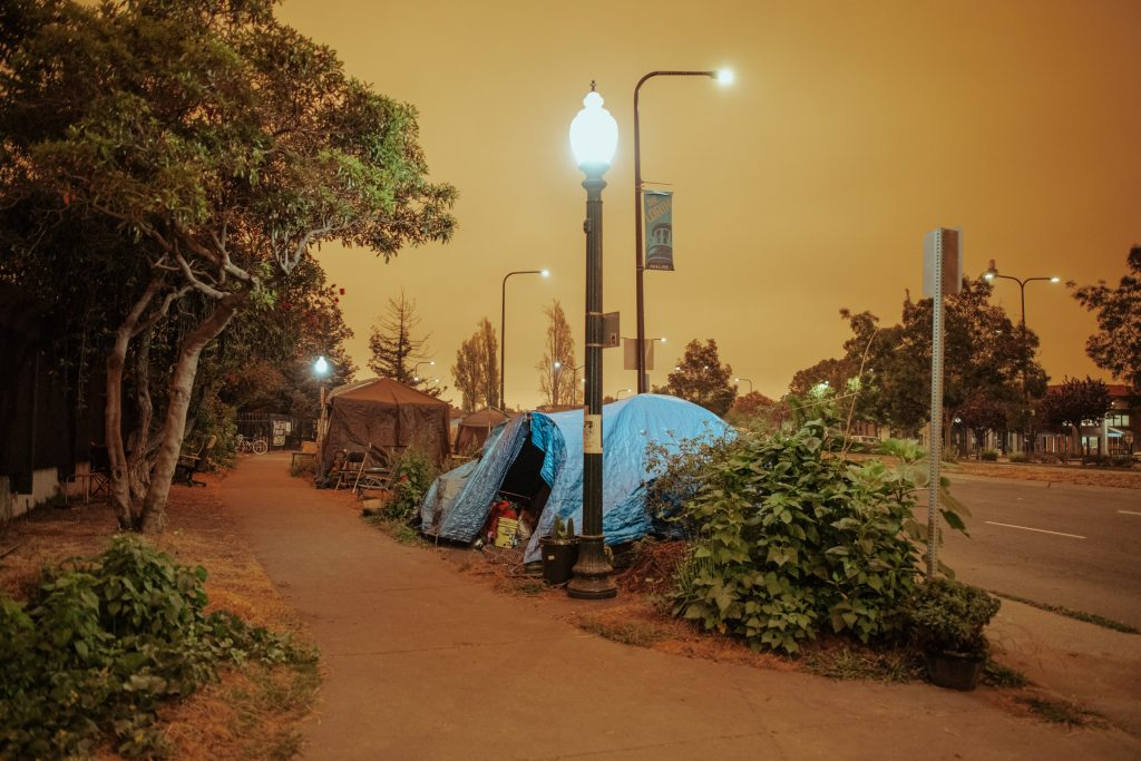 South Berkeley's Here/There encampment underneath an orange sky on September 9, 2020.