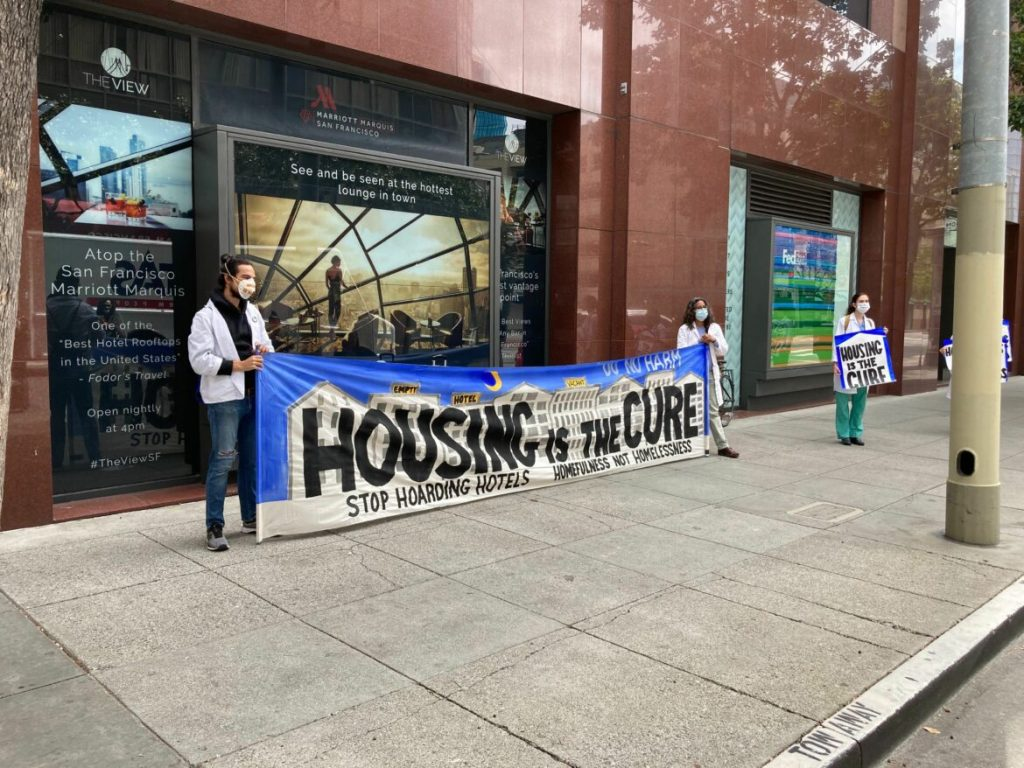 Protesters from POOR magazine attempt to occupy the Marriott Marquis hotel in May, demand the city house more homeless residents in vacant hotel rooms.