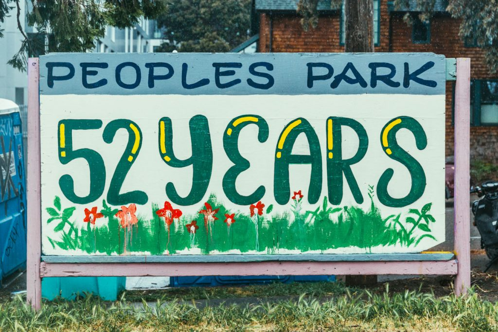 """A hand painted sign that says """"People's Park 52 years"""""""