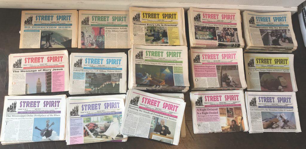 12 stacks of old copies of Street Spirit.