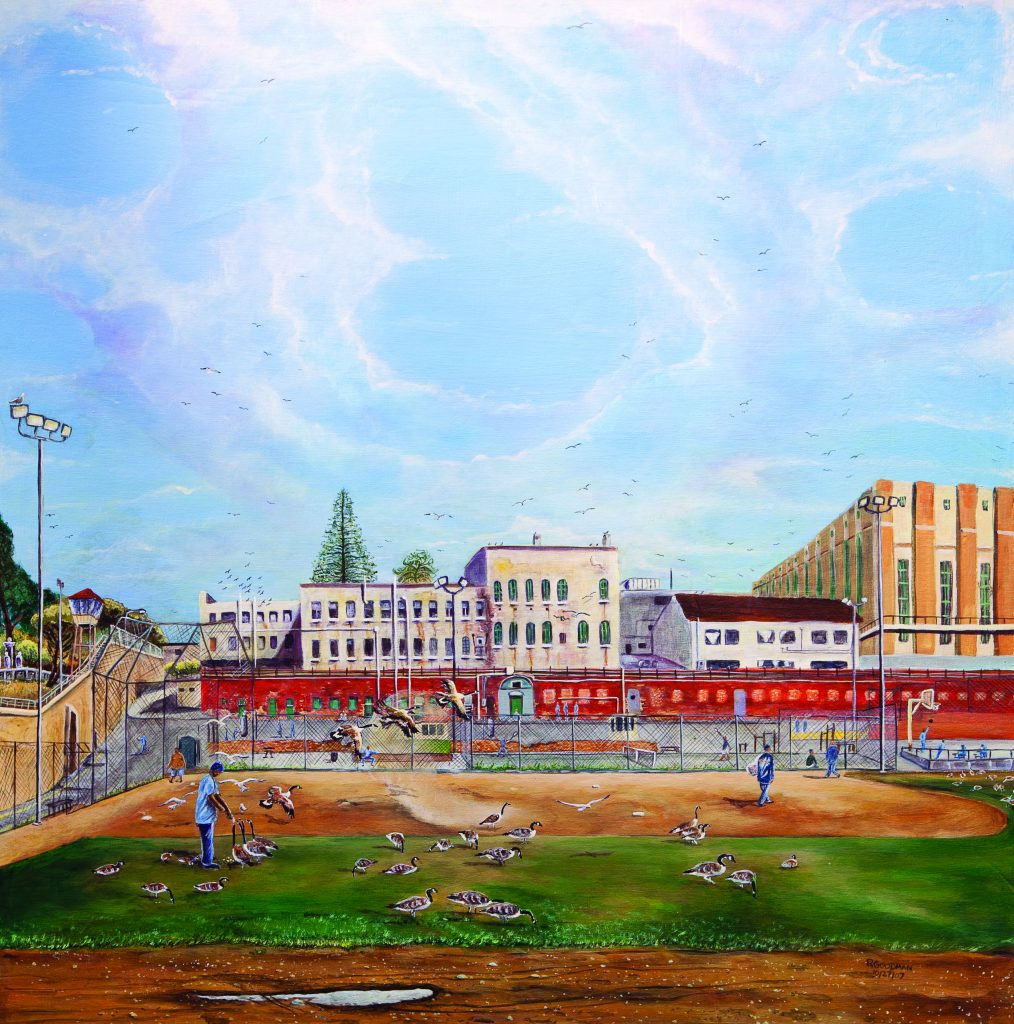 The San Quentin yard: a baseball diamond covered in geese, with brick buildings and fences all around it. Men in blue feed the geese.